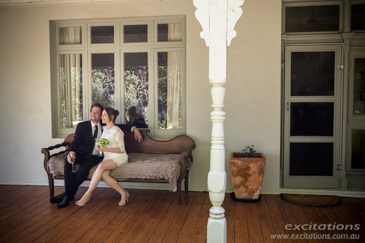 Wide angle candid photo of bride and groom at garden wedding. Historic Merbein garden
