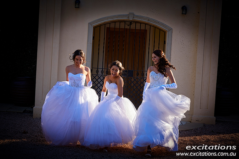 Debutantes on location. Three beautiful young debutantes running towards the camera through a small patch of gorgeous light. Deb photos on location by excitations.