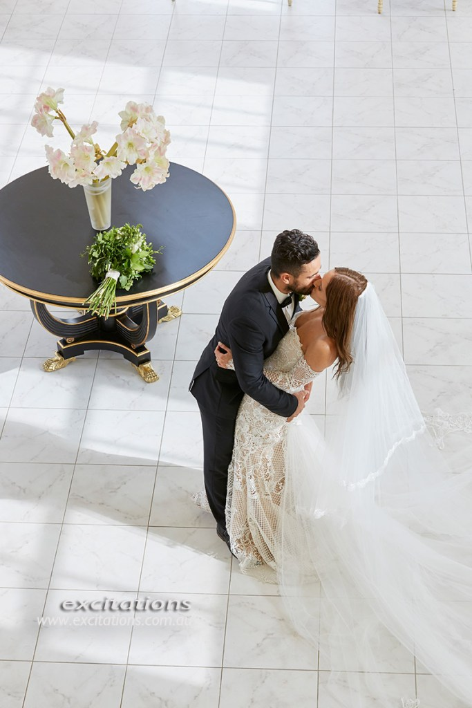 High angle high key image of bride and groom kissing indoors, Jimmba.Mildura wedding photos by Excitations.