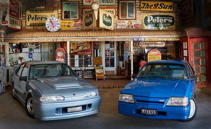Two Australian muscle cars photographed in front of historical store front. Mildura photographer Excitations.