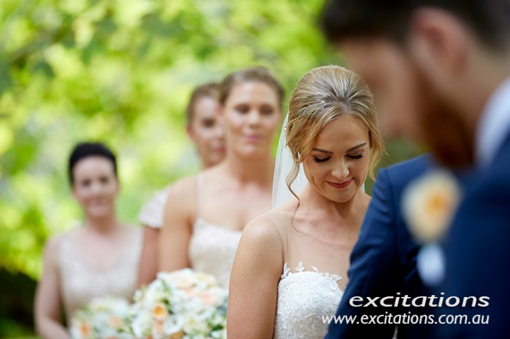 Garden wedding candid photography of bride during ceremony. Mildura wedding photos by Excitations Mildura photographers.