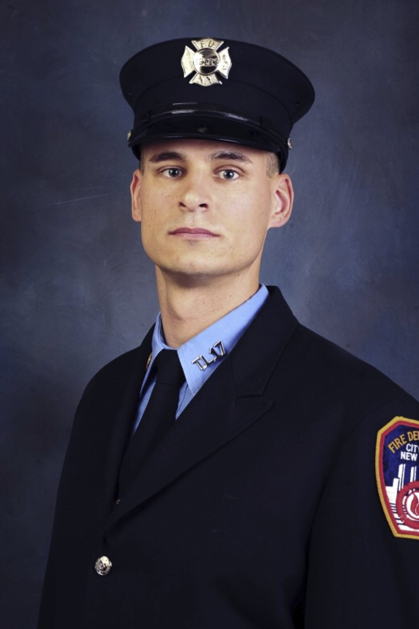 undated, file photo provided on April 9, 2019, by the Fire Department of New York shows firefighter Christopher Slutman_1556280150723.jpeg.jpg