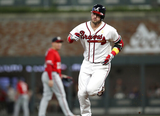 LEADING OFF: Braves streaking, Harper hurting, Arizona rolls