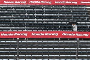 A MotoGP fan walks in the stands at the Twin Ring Motegi circuit ahead of Sunday's Japanese Grand Prix in Motegi, north of Tokyo