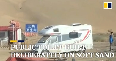 Public toilet in China built deliberately on soft sand to trap tourists' vehicles
