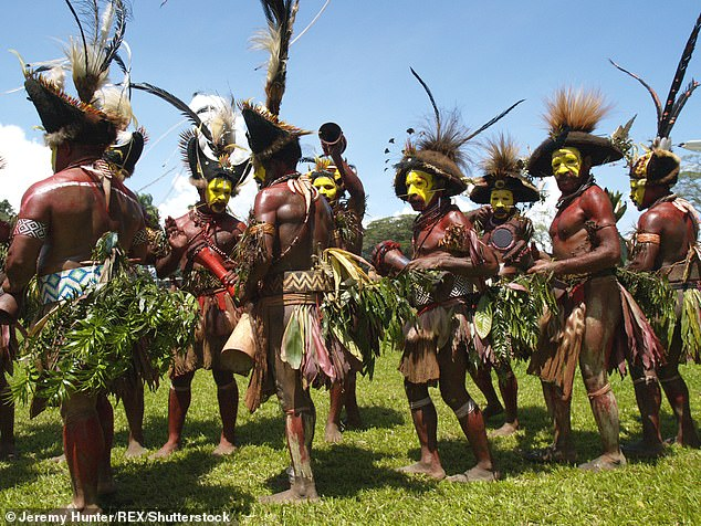 Conventions in Papuan tribal communities (pictured above), in which shared objects and sculptures are used to remember past events, parallel the collection of dated tour T-shirts, or band paraphernalia like drum sticks or plectrums thrown from the stage