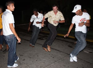 Locals dance on the street in Matanzas, Cuba.