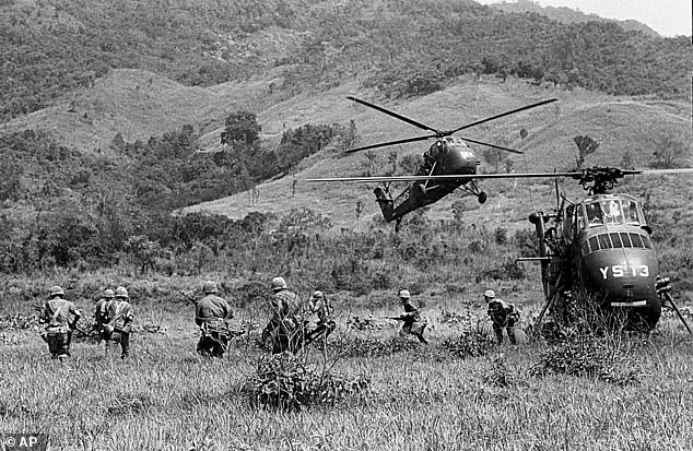 U.S. Marine helicopters leave troops into suspected Viet Cong area during a full fledged assault operation by U.S. Marines near Da Nang, South Vietnam, in this April 29, 1965 black-and-white file photo during the Vietnam War. Researchers now say a solar storm may have impacted the US Navy during a mining operation