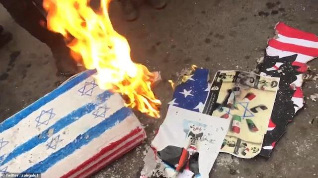 Israeli flags and posters were also set on fire during one of many rallies which took place across the country on Monday