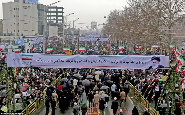 The large turnout at these state-sponsored rallies comes as Iranians faces rising prices and food shortages which have triggered waves of protests (Pictured, crowds at the Azadi Square in Tehran)