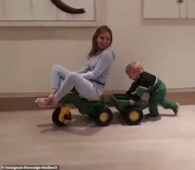 Adorable: Monty, who she shares with Red Bull racing tycoon Christian Horner, looked gorgeous in a black and green jumper paired with bottle green trousers as he got stuck into playtime
