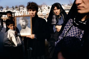 Memory… a family in northern Iraq hold photographs of Kamaran Abdullah Saber, killed aged 20 in 1991 at a student demonstration against Saddam Hussein.