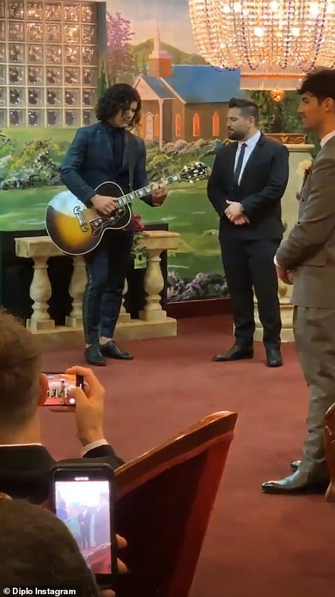 Playing the music: A man played an electric guitar as Sophie walked down the aisle