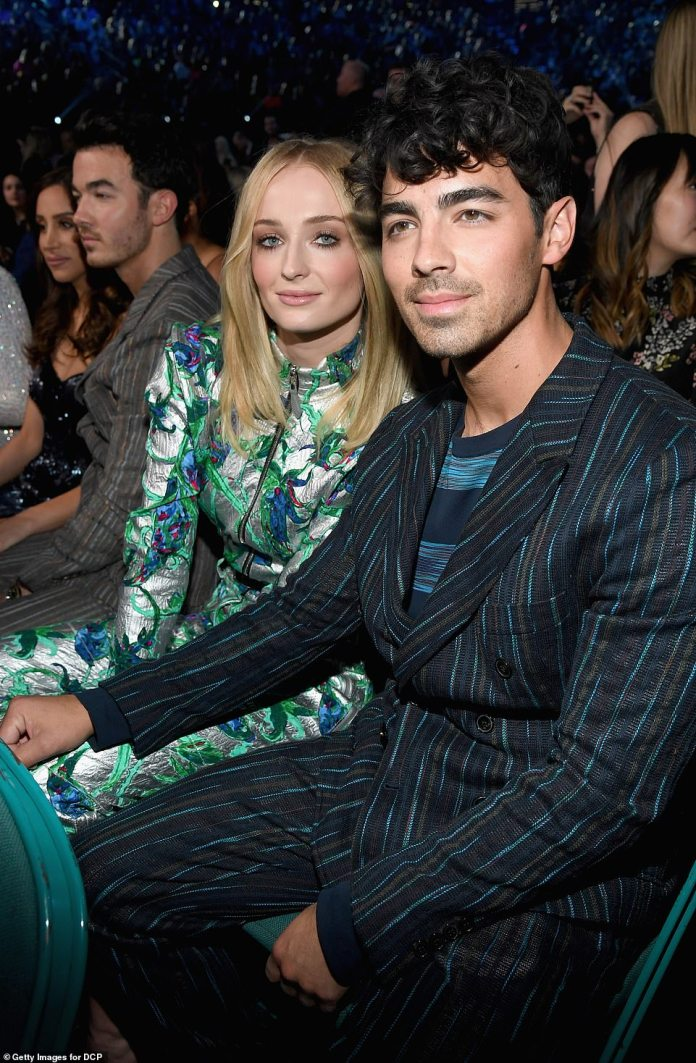 Still single: Just hours before getting hitched, Joe and Sophie were snapped sitting next to each other at the MGM Grand Garden Arena where the Billboard Music Awards were held