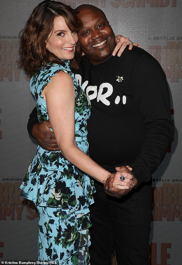 Tina and Tituss: Fey also posed on the red carpet with a dancing pose with Tituss Burgess, who was wearing a black Dior sweatshirt, black pants and sneakers