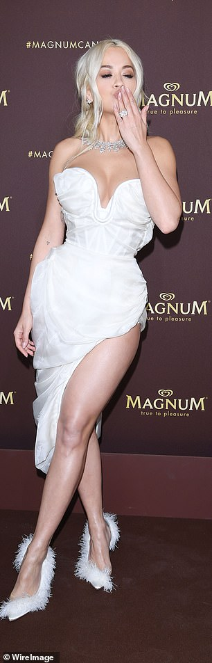 Rita showed off her incredible figure in her stunning strapless dress, which featured a plunging bustier top