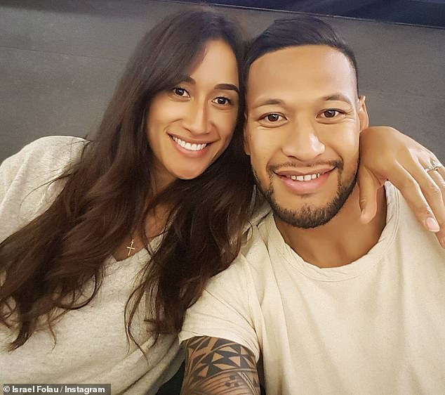 The Wallabies star (pictured with his wife), 30, has been sacked from the Australia team