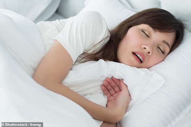 Stock photo: Experts believe people who sleep for too long may have poorer sleep quality, which prevents regions of the brain communicating properly and puts them at risk of cognitive issues.