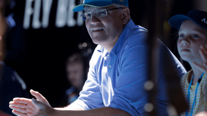 FILE - In this Jan 20, 2019, file photo, Australian Prime Minister Scott Morrison watches the fourth round match between Australia's Ashleigh Barty and Russia's Maria Sharapova on Rod Laver Arena at the Australian Open tennis championships in Melbourne, Australia. Saturday, May 18, 2019 is the last possible date that Morrison could have realistically chosen to hold an election. (AP Photo/Mark Schiefelbein, File)