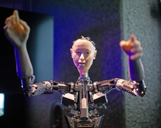 Roboticist Hiroshi Ishiguro's 'Alter', a machine body with a human like face and hands who learns through interplaying, on display at the 'AI: More Than Human' exhibition at the Barbican Centre in London. The major new exhibition explores the relationship between humans and artificial intelligence. PRESS ASSOCIATION Photo. Picture date: Wednesday May 15, 2019. Photo credit should read: Aaron Chown/PA Wire
