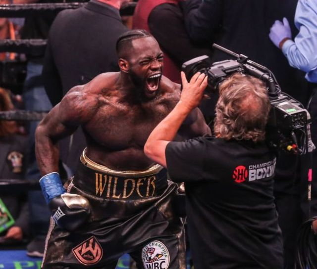 NEW YORK, NEW YORK - MAY 18: Deontay Wilder screams at the camera after knocking out Dominic Breazeale in the first round during their bout for Wilder's WBC heavyweight championship at Barclays Center on May 18, 2019 in New York City. (Photo by Anthony Geathers/Getty Images)