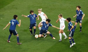 England's Ellen White in action with Japan's Nana Ichise and Emi Nakajima.