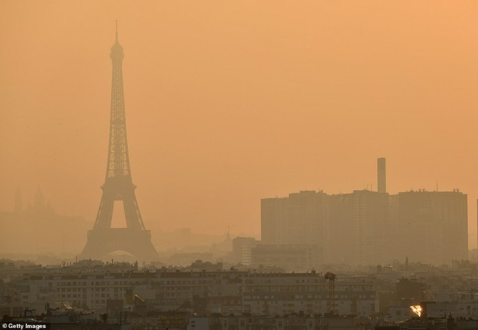 Paris woke up to a thick cloud of smog on Wednesday as strong jet stream winds drew clouds of dust up from the Sahara