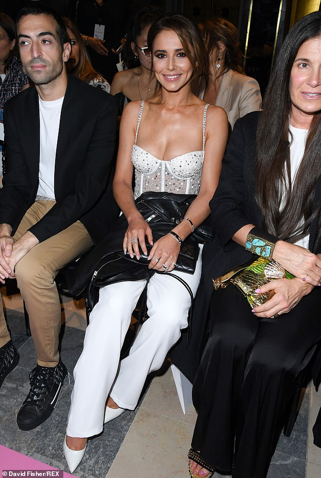 Chic:Cheryl looked chic in pointed white stiletto boots as she took her place on the front row of the fashion show