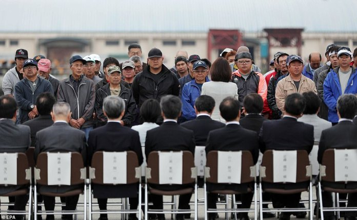 Fishermen line up to take part in a ceremony attended by members of the public to bless their trip on Monday morning in Kushiro, Hokkaido