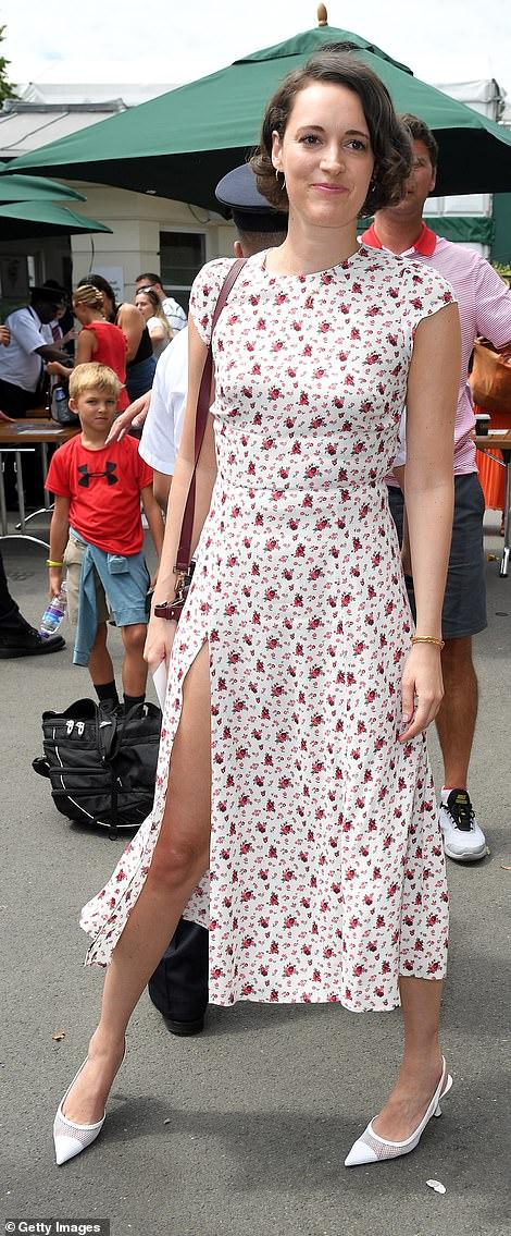 Floral finesse: The Fleabag creator, 33, exuded elegance in a chic white dress, adorned with vibrant scarlet rose print