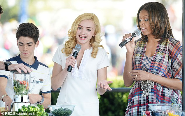 Cameron was invited the the White House in 2014 by President Obama. Here is pictured making a healthy drink during the annual White House Easter Egg Roll with former First Lady Michelle Obama and fellow Disney channel star Peyton List