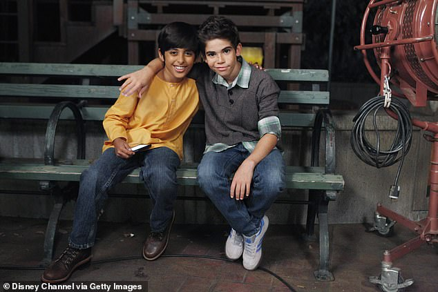A Disney spokesperson said: 'From a young age, Cameron Boyce dreamed of sharing his extraordinary artistic talents with the world' Pictured: on set of Jessie with Karan Brar