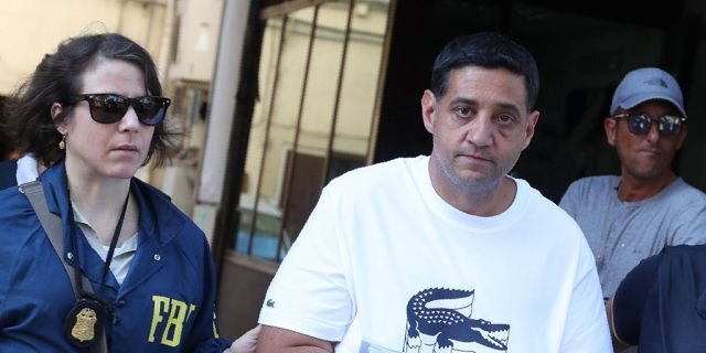Suspect Thomas Gambino, right, is taken into custody during an anti-mafia operation lead by the Italian Police and the FBI in Palermo, Southern Italy, Wednesday, July 17, 2019. Italian police and the FBI arrested 19 suspected Mafiosi in a joint operation Wednesday following an investigation which revealed alleged ties between Sicily's Cosa Nostra Mafia and New York's Gambino crime family.