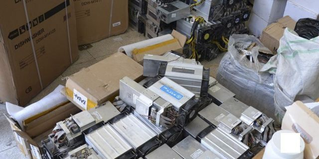 """This undated photo provided by the Police News Agency, shows boxes of machinery used in Bitcoin """"mining"""" operations that were confiscated by police in Nazarabad, Iran. (News.police.ir via AP)"""