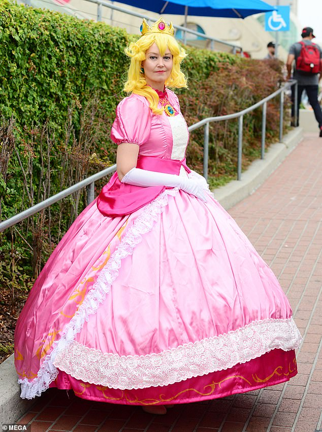 Cosplayer dresses as Princess Peach from Nintendo's 'Mario' franchise. Peach is the princess of the fictional Mushroom kingdom
