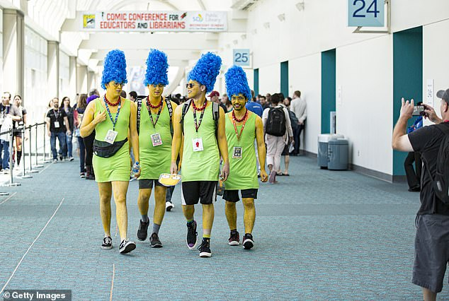 Cosplayers dress as four Marge Simpsons