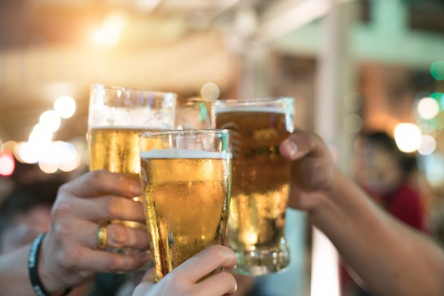 people toasting with pints of beer