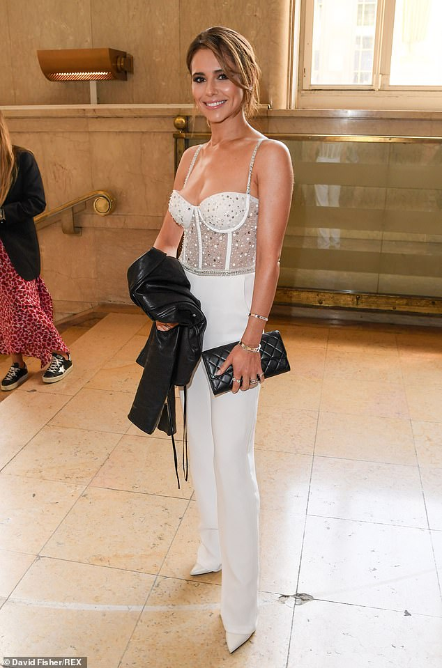 Wow!Cheryl, 36, dazzled in her sexiest look yet as she stepped out in a jewel-encrusted corset and sleek white trousers to attend the Georges Hobeika couture show in Paris on Monday