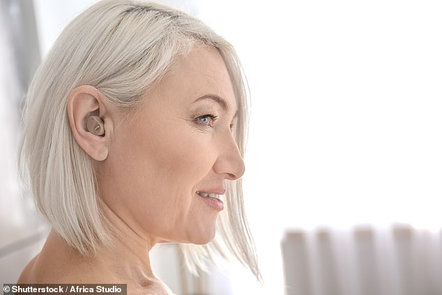 Hearing aids may protect deaf people from dementia, research suggests (stock image)