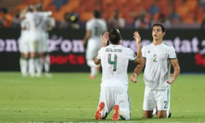 Algeria's Djamel Benlamri and Aissa Mandi celebrate after William Troost-Ekong's own goal.