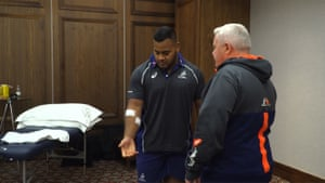 Rugby player Taniela Tupou (left) displays his arm injuries after he was the victim of a robbery in Johannesburg.