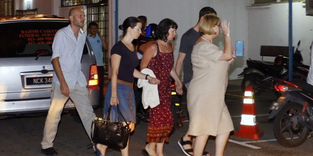 Family members of missing British girl Nora Anne Quoirin arrive at a hospital morgue in Seremban, Negeri Sembilan, Malaysia, Tuesday, Aug. 13, 2019. (AP Photo/Lai Seng Sin)