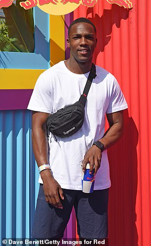 Stylish: Actor Tosin Cole sported a casual look in a white T-shirt and shorts