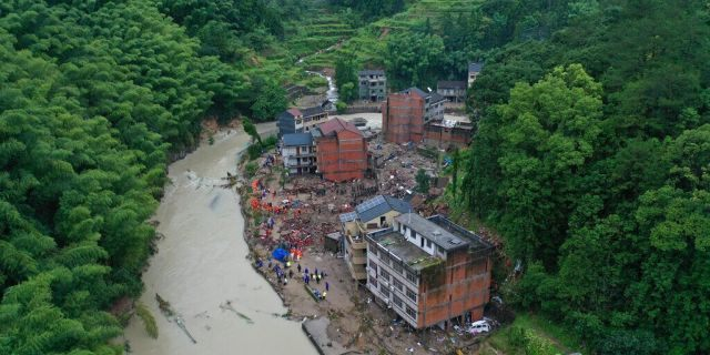 Rescuers search for victims of a landslide triggered by Typhoon Lekima in Yongjia county in eastern China's Zhejiang province on Saturday, Aug. 10, 2019.