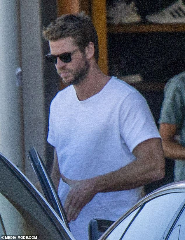 Moving on: Liam Hemsworth has filed for divorce from wife Miley Cyrus, 11 days after the couple announced their separation after just seven months of marriage. He is pictured in Byron Bay on Tuesday