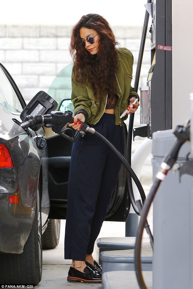 Gimme Gas: Vanessa Hudgens pumped her own gas in LA while simultaneously showing off her bright red freshly manicured nails on Monday