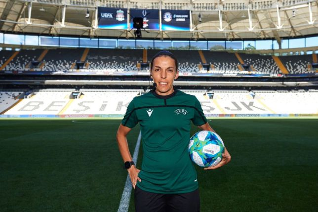 Referee Stephanie Frappart poses with the Super Cup match ball on the pitch at Besiktas Park in Turkey
