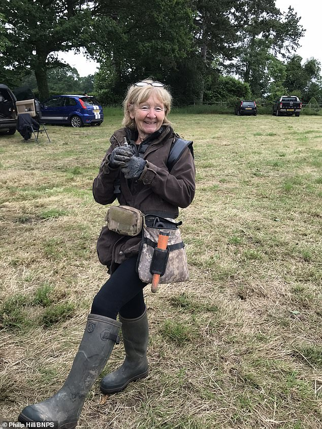 Retired postlady Sue Kilvert, 66, uncovered the gold posy ring while inspecting a field next to Shakespeare Hall in Rowington, Warwickshire