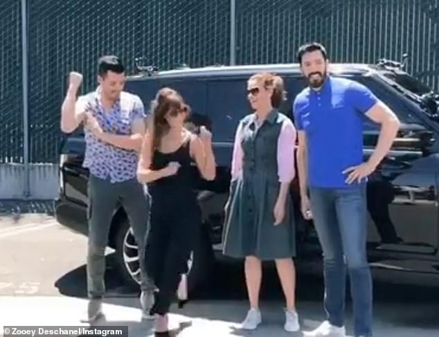 And Deschanel (2-L) coyly captioned her Instagram: 'One of us was very excited about taping @carpoolkaraoke yesterday. Maybe two of us'