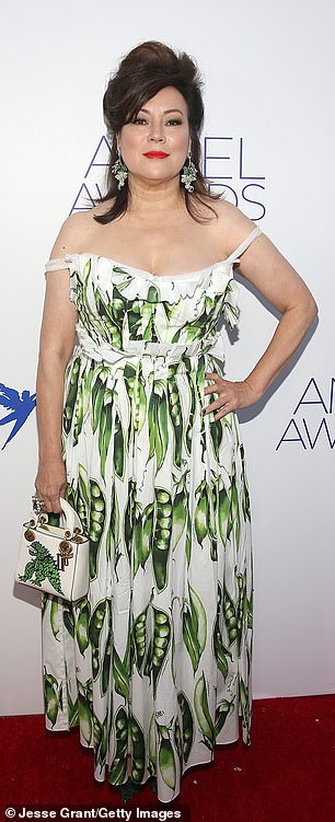 Bound alum: The 60-year-old Oscar nominee bared her shoulders in a green pea pod-print dress and matching dino purse
